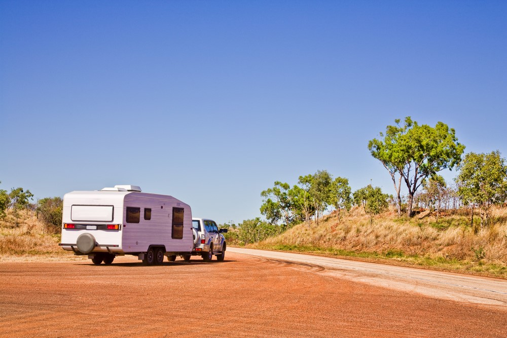 White car and caravan in the Australian outback